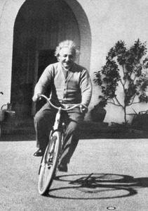 Albert Einstein on a bicycle